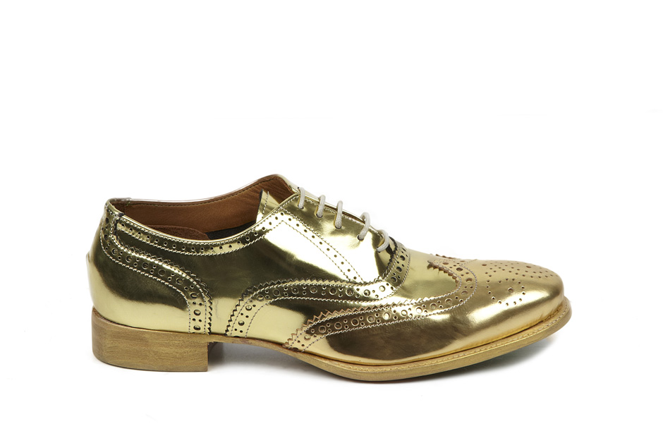 Made from high-shine silver leather in a brogue silhouette, these shoes are set on a chunky jute and bright-green striped foam sole. Wear yours with clashing colors and prints. Color: metallicPrice: $