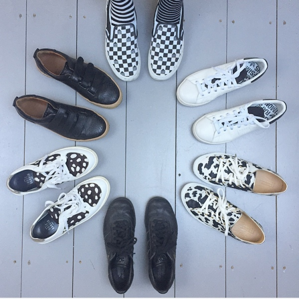 En Brogue wearing black and white trainers